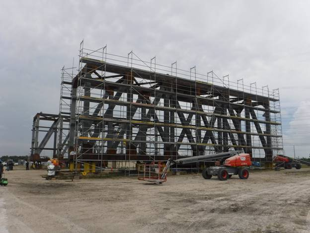 Painting scaffold surrounds one of the three cradle sections fabricated by TTI-FSS at its Port Tampa facility for Louisiana-based coal ship loaders.